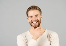 bigstock-Happy-Man-Touch-Beard-On-Unsha-229845055-270x191 Dental Services | One Smile Dental